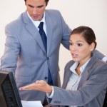 Business analyzing statistics together — Stock Photo