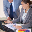 Business working on diagrams together — Stock Photo