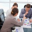 Business team discussing over market research — Stock Photo