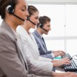 Side view of customer service assistants — Stock Photo #11208395
