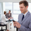 Stock Photo: Sales manager writing text message
