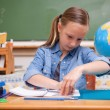 Schoolgirl doing classwork — Stock Photo
