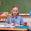 Cute schoolgirl doing classwork — Stock Photo #11208508