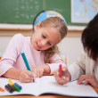 Stock Photo: Cute schoolgirls drawing