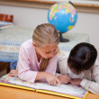 Schoolgirls reading a fairy tale — Stock Photo