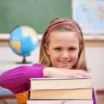 Portrait of schoolgirl posing with books — Stock Photo