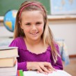 Portrait of young schoolgirl reading a book - Stock Photo