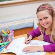Portrait of a schoolgirl drawing - Stock Photo