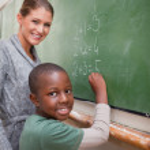 Portrait of a teacher explaining mathematics to a pupil — Stock Photo