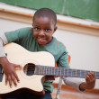 Portrait of a schoolboy playing the guitar — Stock Photo