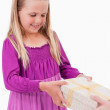 Portrait of a girl receiving a present — Stock Photo