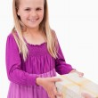 Portrait of a happy girl receiving a present — Stock Photo