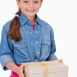 Portrait of a girl holding a gift box — Stock Photo