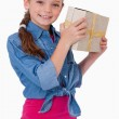 Portrait of a happy girl holding a gift box — Stock Photo