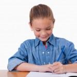 Little girl writing — Stock Photo