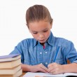 Serious girl writing on a notebook — Stock Photo #11209055