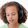 Young girl listening to music — Stock Photo