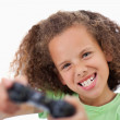 Girl playing a video game — Stock Photo