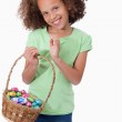Portrait of a cute girl holding a basket full of Easter eggs — Stock Photo