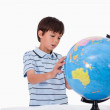 Boy looking at a globe — Stock Photo #11209251
