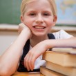 Portrait of a girl leaning on books — Stock Photo