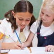 Stock Photo: Pupils drawing together