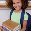 Portrait of a schoolgirl holding her books — Stock Photo