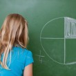 Schoolgirl learning the divisions — Stock Photo