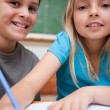 Portrait of two children writing — Stock Photo