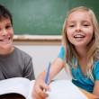 Two children writing — Stockfoto