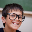 Close up of a smiling schoolboy — Stock Photo