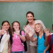 Schoolteacher and her pupils waving at the camera — Stock Photo
