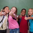 Stock Photo: Classmates posing with thumb up