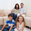Cheerful family in the living room - Stock Photo