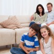 Happy family in the living room - Stock Photo