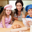 Mother and her children preparing cookies — Stock Photo