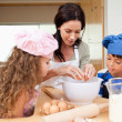 Mother making cookies with her kids — Stock Photo #11209593