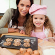 Mother and daughter with cookies — Stock Photo