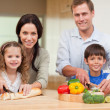 Stock Photo: Family cutting ingredients