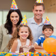 Smiling family celebrating birthday — Stock Photo