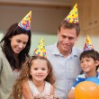 Stock Photo: Family celebrating daughters birthday