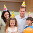 Stock Photo: Happy family celebrating daughters birthday