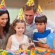 Girl blew out the candles on her birthday cake - Stock Photo