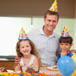 Father celebrating birthday with his kids — Stock Photo