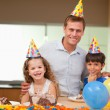Father celebrating birthday with his kids - Stock Photo