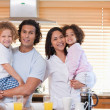 Family having breakfast in the kitchen together — Stock Photo