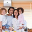 Stock Photo: Family having breakfast in the kitchen