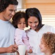 Family enjoys having breakfast together — Stock Photo #11209806