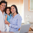 Smiling family together in the kitchen - Foto de Stock