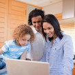 Happy family surfing the internet in the kitchen together — Stock Photo #11209852